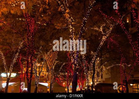 WA07921-00...WASHINGTON - A Menorah among the Christmas lights at Westlake Park in downtown Seattle. - Stock Photo