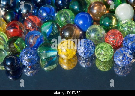 Marbles on a reflective surface - Stock Photo