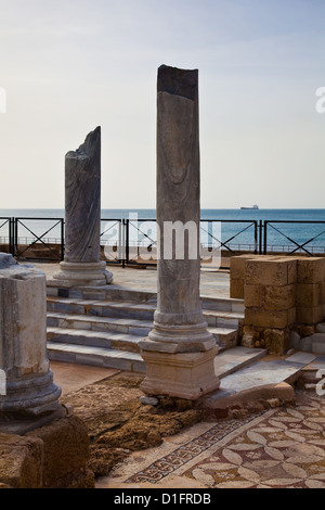 Mosaic floor and marble columns of the Roman baths in Caesarea, Israel - Stock Photo
