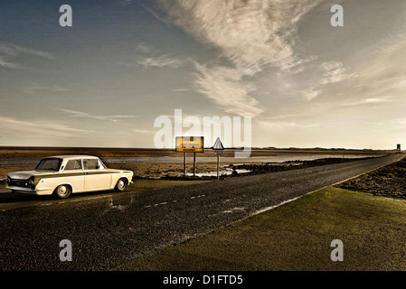 Ford Lotus-Cortina MK1 1965 on Holy Island Causeway Northumberland - Stock Photo