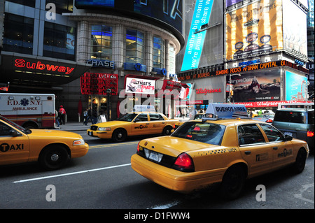 Yellow Taxicab during traffic on Time Square Manhttan New York - Stock Photo