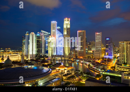 Skyline and Financial district at dusk, Singapore, Southeast Asia, Asia - Stock Photo