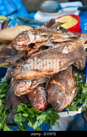 Fried talapia fish in the market at Santiago Sacatepequez, Guatemala, Central America - Stock Photo