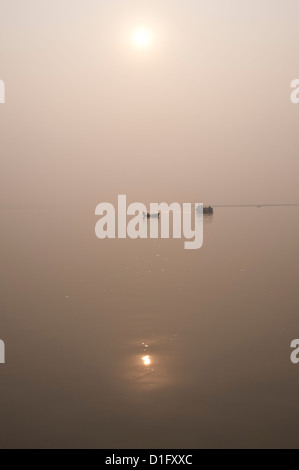 Fishing boat and river ferry on the River Ganges in the early morning, Sonepur, Bihar, India, Asia - Stock Photo
