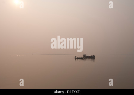 Fishing boats and ferry on the River Ganges in the early morning, Sonepur, Bihar, India, Asia - Stock Photo