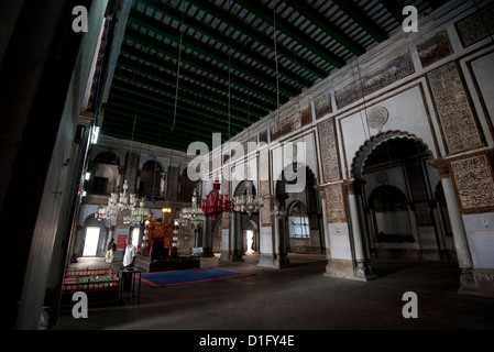 Mosque interior with holy dais and glass lanterns, in the Hugli Imambara, on the bank of the Hugli river, West Bengal, - Stock Photo