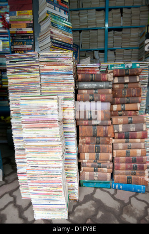 Piles of secondhand books for sale in College Street, famous for its book stalls, North Kolkata, West Bengal, India, - Stock Photo