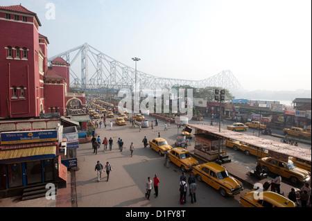 View of Howrah Bridge across the River Hugli from Howrah Railway Station, Kolkata (Calcutta), West Bengal, India - Stock Photo