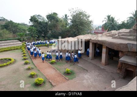 Local schoolchildren in school uniform visiting Ranigumpha, cave number 1, Udayagiri caves, Bhubaneshwar, Orissa, - Stock Photo