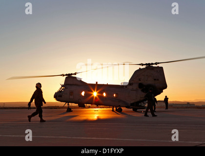 A US Marine Corps pilot prepares to board the last CH-46 Sea Knight helicopter from the Marine Medium Helicopter - Stock Photo