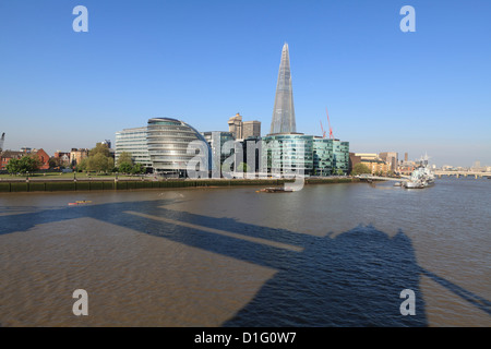 South Bank with City Hall, Shard London Bridge, the shadow of Tower Bridge in the foreground, London, England - Stock Photo