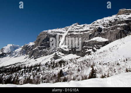 Snow-covered rocks in the French Alps, Plateau d'Assy, Haute-Savoie, France, Europe - Stock Photo