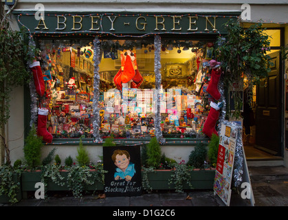 Abbey Green shop in Bath UK with its window dressed for Christmas sells novelty gifts and cards - Stock Photo