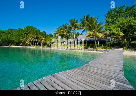 Wooden pier leadin to a resort on Aore islet before the Island of Espiritu Santo, Vanuatu, South Pacific, Pacific - Stock Photo