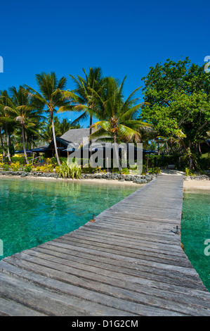 Wooden pier leading to a resort on Aore islet before the Island of Espiritu Santo, Vanuatu, South Pacific, Pacific - Stock Photo