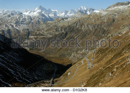 view from the Furka road in the Swiss Alps towards the Grimsel pass road and the Bernese Alps - Stock Photo