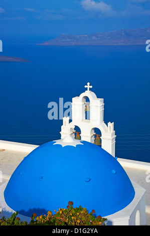 Church with blue dome overlooking the Aegean, Fira, Thira, Santorini, Cyclades, Greek Islands, Greece, Europe - Stock Photo