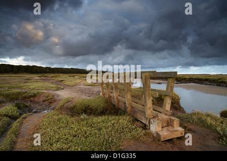 Stromy clouds over the saltmarshes at Stiffkey, Norfolk, England, United Kingdom, Europe - Stock Photo