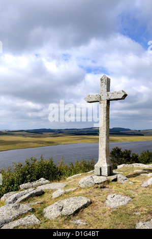 Cross at St Andeol lake on the Way of St James in Lozere, Aubrac, France, Europe - pilgrimage route to Santiago - Stock Photo