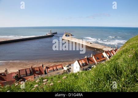 Whitby harbour walls and lighthouses from the clifftop, Whitby, North Yorkshire, Yorkshire, England, United Kingdom, - Stock Photo