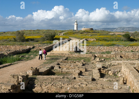 View over ruined Roman town to the lighthouse, The Agora, Archaeological Park, Paphos, Cyprus, Europe - Stock Photo