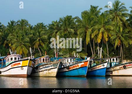 Fishing boats along the Backwaters, near Alappuzha (Alleppey), Kerala, India, Asia - Stock Photo