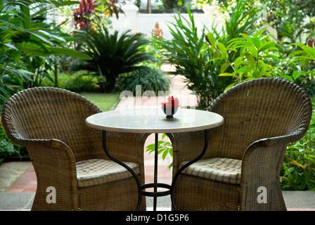 Terrace table and chairs in hotel, Kochi (Cochin), Kerala, India, Asia