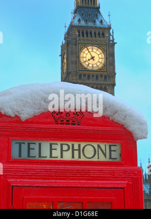 Red phone box and Big Ben in snow, Parliament Square, London, England, United Kingdom, Europe - Stock Photo