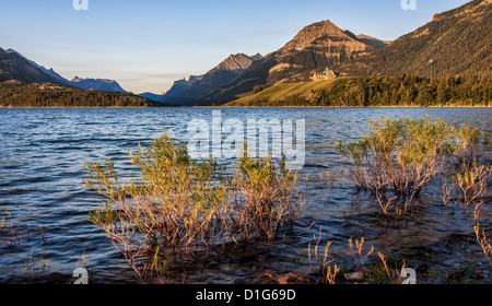 Across the lake is the Prince of Wales Hotel and the far end of the lake is Glacier National Park in the States. - Stock Photo