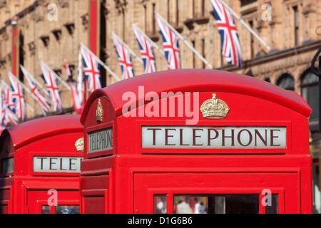 Red telephone boxes opposite Harrod's, Knightsbridge, London, England, United Kingdom, Europe - Stock Photo