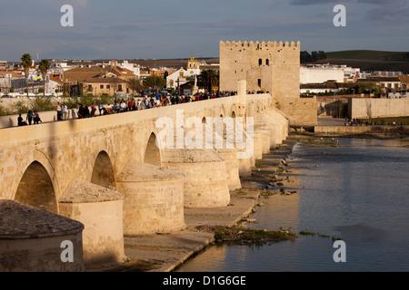 Roman Bridge and Calahorra Tower (Spanish: Torre de la Calahorra) at sunset in Cordoba, Spain. - Stock Photo