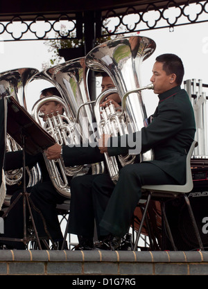 Three members of the Regimental Band of The Brigade of Gurkhas during their concert  at Deal Memorial bandstand - Stock Photo