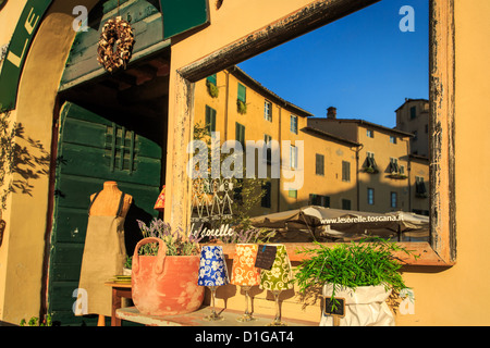 A refection in a mirror of Piazza dell'Anfiteatro, Lucca, Tuscany, Italy, Europe - Stock Photo