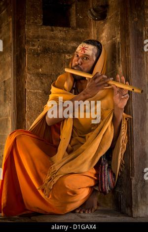 Sadhu or holy man with a flute, Pashupatinath, Kathmandu, Nepal - Stock Photo