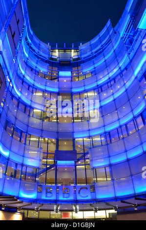 Broadcasting House at night with new east wing extension and BBC logo sign - Stock Photo