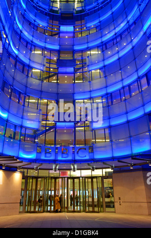 Broadcasting House entrance at night with new east wing extension and BBC logo sign - Stock Photo