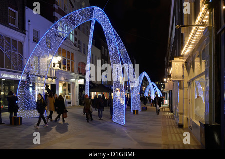 Mayfair West End London shops and Christmas lights - Stock Photo
