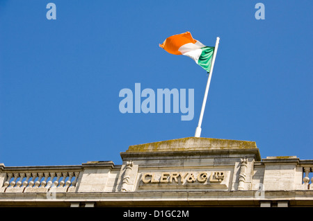 Horizontal view of the Irish national flag flying high above Clery & Co department store in Dublin. - Stock Photo