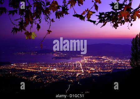 Panoramic night view of Volos city from Makrinitsa village, Pelion mountain, Magnesia, Thessaly, Greece. - Stock Photo