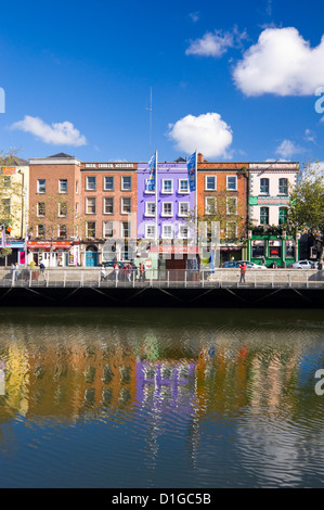 Vertical view of the colourful buildings along Batchelor's Walk reflected in the River Liffey in Dublin on a sunny - Stock Photo