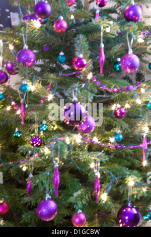 Blurred out of focus Christmas tree lights and baubles, abstract twinkling lights background. - Stock Photo