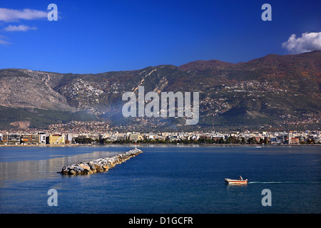 Panoramic  view of Volos city. In the background Pelion mountain with some of its villages, Thessaly, Greece. - Stock Photo