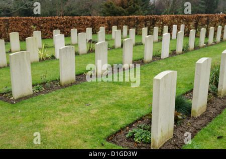 long rows of unnamed commemoration headstones of world war 1 British soldiers on bleak cold day - Stock Photo
