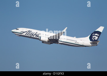 LOS ANGELES, CALIFORNIA, USA - DECEMBER 11, 2012 - Alaska Airlines Boeing 737-990 takes off from Los Angeles Airport. - Stock Photo