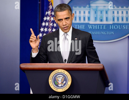 United States President Barack Obama answers reporter's questions after making a statement about how his administration - Stock Photo
