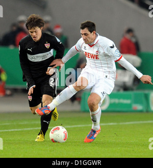 Stuttgart's Gotoku Dakai (L) vies for the ball with Cologne's Jajalo Mato (R) during the DFB Cup soccer match between - Stock Photo