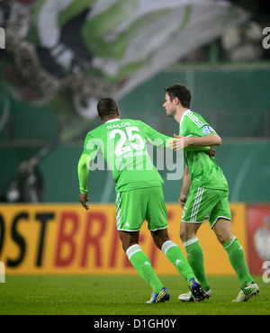 Wolfsburg's Christian Traesch cheers with his teammate Naldo (L) after scoring the 1-1 equaliter in the DFB Cup - Stock Photo
