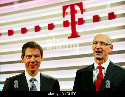 Deutsche Telekom CEO Rene Obermann (L) and CFO Timotheus Hoettges (R) arrive for the telecommunication group's balance - Stock Photo