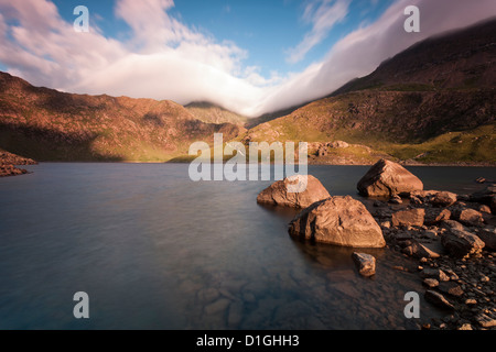 View over Llyn Llydaw looking at cloud covered peak of Snowdon, Snowdonia National Park, Wales, United Kingdom, - Stock Photo