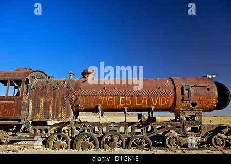 Rusting old steam locomotive at the Train cemetery (train graveyard), Uyuni, Southwest, Bolivia, South America - Stock Photo